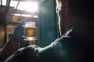 Worker holding beer glass